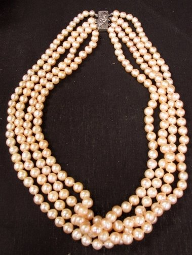 1575: FOUR STRAND PINK PEARLS.