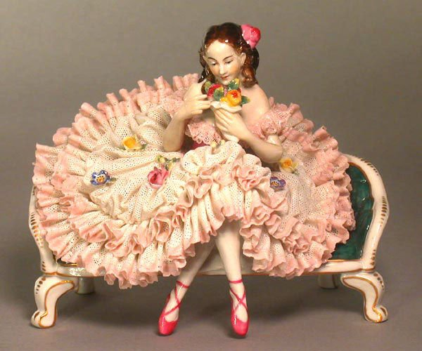 2017: PORCELAIN FIGURE OF A SEATED GIRL. c. p