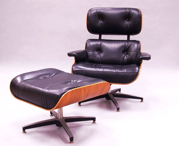 3022: EAMES STYLE LOUNGE CHAIRS AND OTTOMAN.