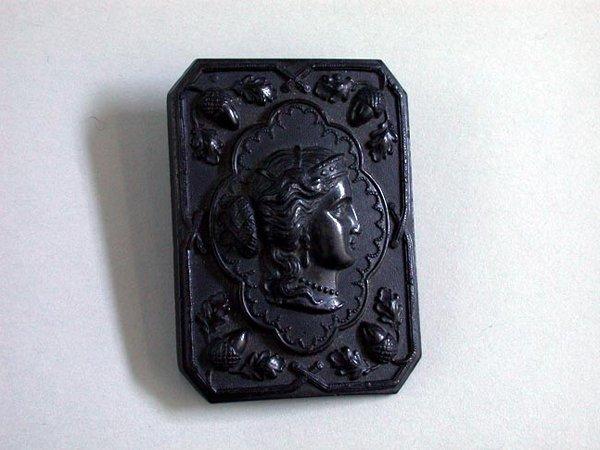 13: GUTTA PERCHA BROOCH N/R. Pin shows carved