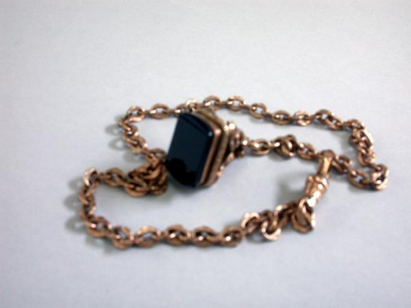 17: 14K WATCH FOB N/R. The rose gold fob is t