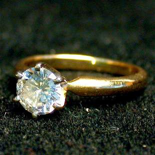 14K SOLITAIRE DIAMOND RING. The ring ha