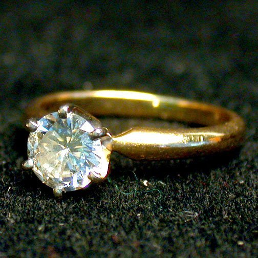 2009: 14K SOLITAIRE DIAMOND RING. The ring ha