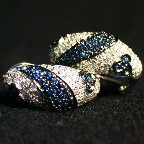 2010: 14K SAPPHIRE EARRINGS. The white gold e