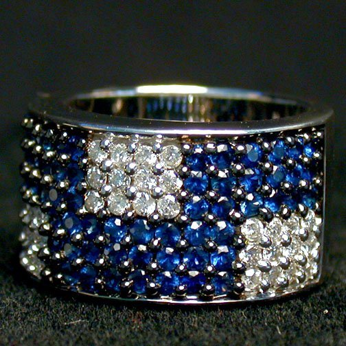2011: 14K SAPPHIRE & DIAMOND RING. The white