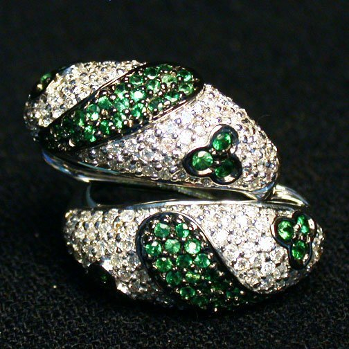 2012: 14K GREEN SAPPHIRE EARRINGS. The pave d
