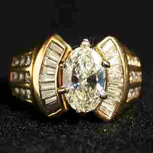 14K DIAMOND RING. The ring has a center