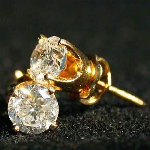 14K DIAMOND STUD EARRINGS. The earrings