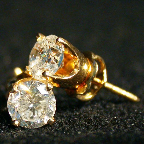 2015: 14K DIAMOND STUD EARRINGS. The earrings