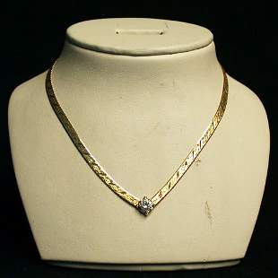 14K DIAMOND SOLITAIRE NECKLACE. The int