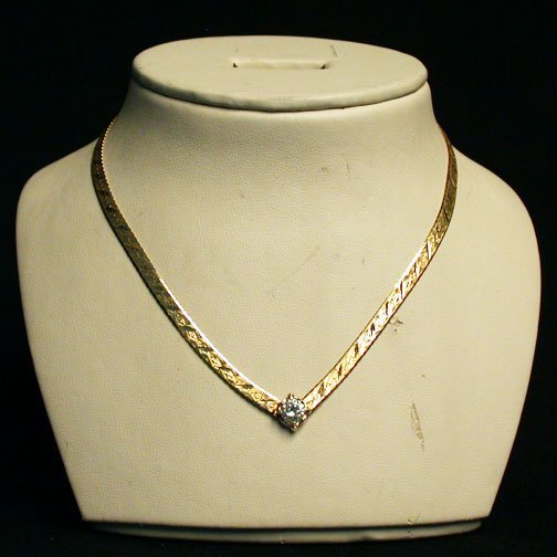 2016: 14K DIAMOND SOLITAIRE NECKLACE. The int