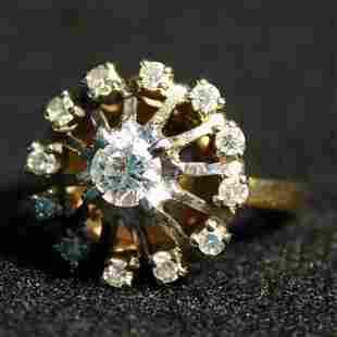 14K DIAMOND DINNER RING. The ring has a