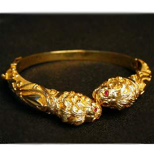 14K LION'S HEAD BANGLE. The bracelet ha