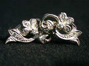 14K DIAMOND EARRINGS. The white gold ea