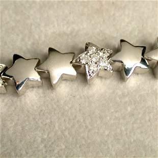 14K DIAMOND STAR BRACELET. The white go