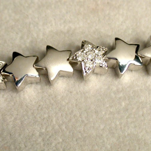 2021: 14K DIAMOND STAR BRACELET. The white go
