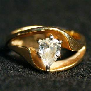14K DIAMOND RING. The ring has a pear s