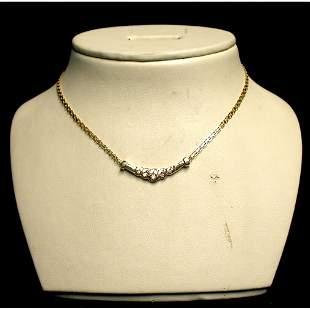 14K DIAMOND NECKLACE. The necklace has