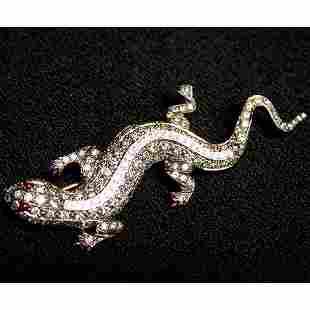 18K LIZARD PIN. The rose gold lizard ha