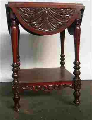 CARVED DROPLEAF OCCASIONAL TABLE.