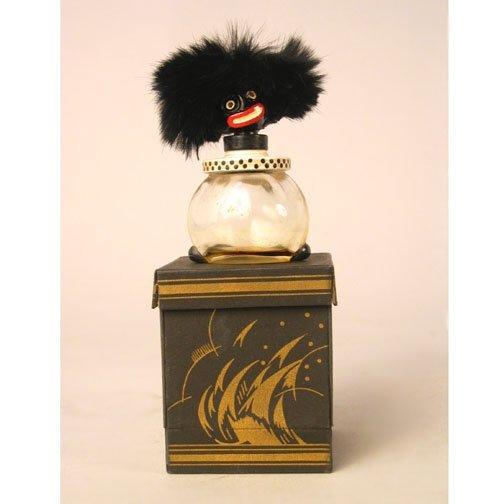 1022: BLACK FACE PERFUME BOTTLE. N/R. Fatice