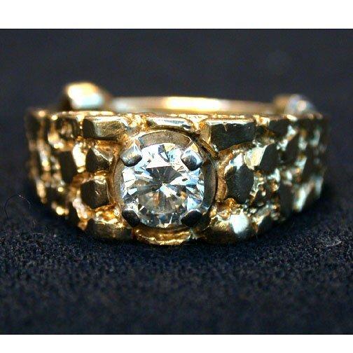 2003: MAN'S DIAMOND RING. The round cut diamo