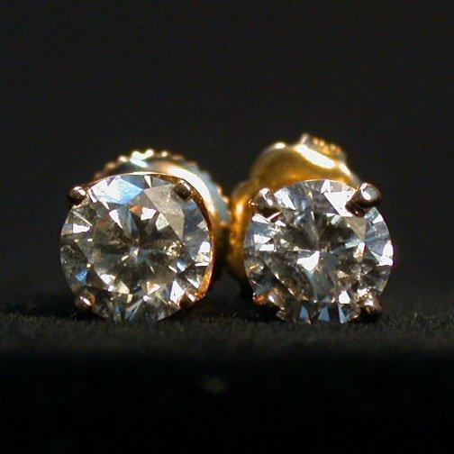 2013: DIAMOND STUD EARRINGS. The pierced back