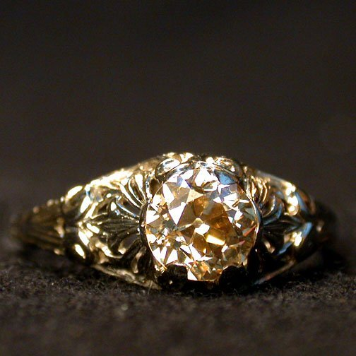 2014: ANTIQUE DIAMOND SOLITAIRE. The yellowis