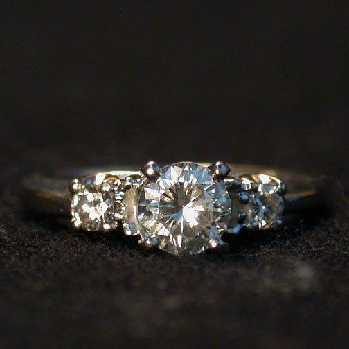 2016: 14K THREE DIAMOND RING. The ring has a