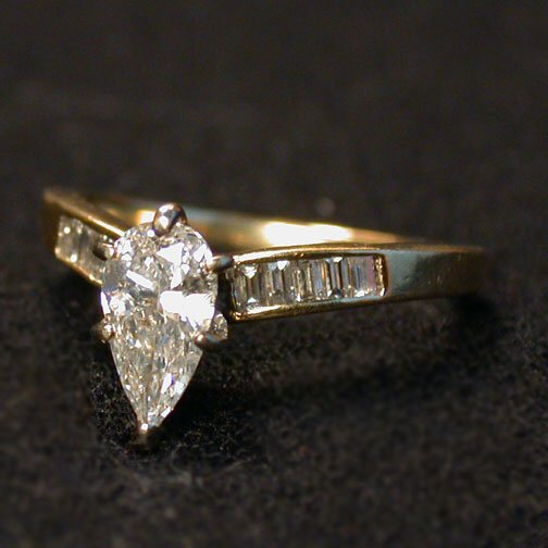 2018: PEAR-SHAPED DIAMOND SOLITAIRE. The .65