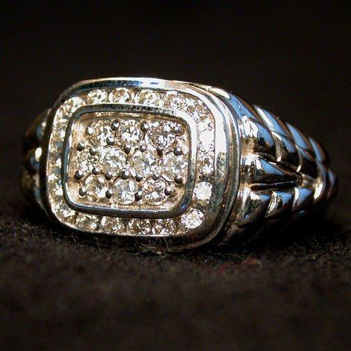 2020: MAN'S 14K DIAMOND RING. The ring has ro
