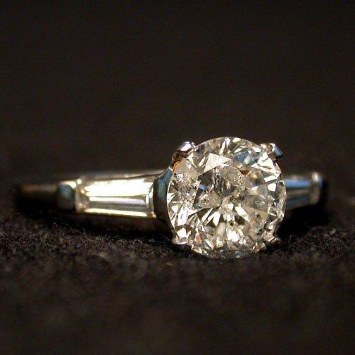 2022: PLATINUM DIAMOND RING. The 1.20 ct. rou