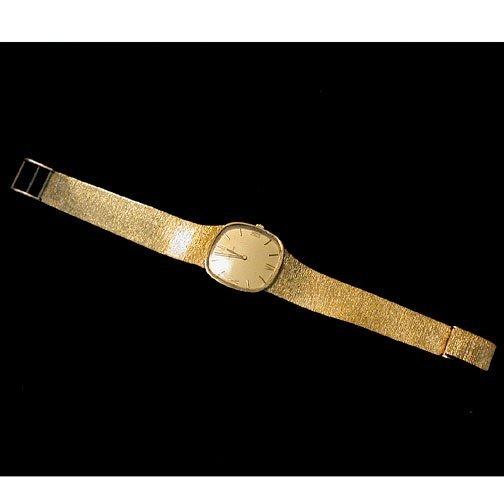 "2023: MAN'S 14K ""MOVADO"" WATCH. The watch has"