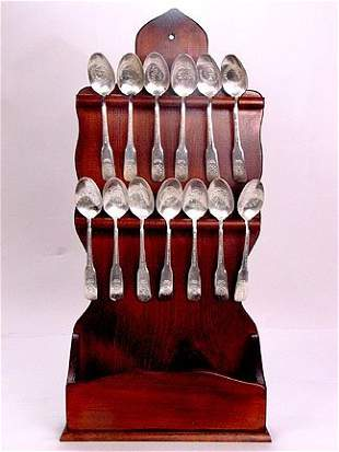 BICENTENNIAL SPOONS IN STAND. Wooden stand with 1