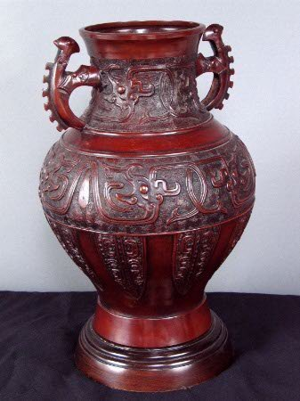 3230: CHINESE METAL VESSEL. Two handled bronze colored
