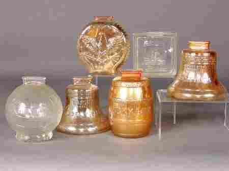 6 GLASS BANKS. 1. Two Liberty Bell banks, iridesc