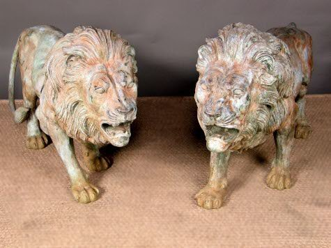 1262t: PAIR OF LARGE BRONZE LIONS.  Consignor claims he