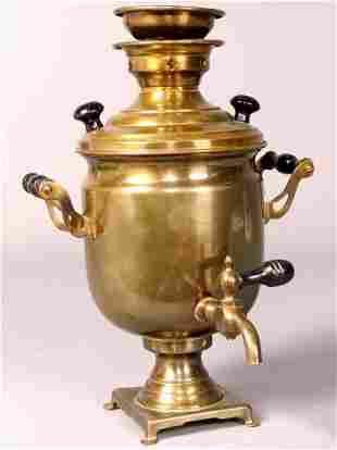 SMALL SAMOVAR. Brass samovar on four feet with eb