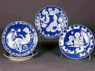 4 ROYAL COPENHAGEN PLATES. Four blue and white po
