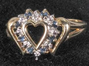 DIAMOND & SAPPHIRE HEART RING. The ring has an al