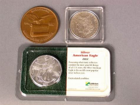 1009: 2 US SILVER COINS PLUS.