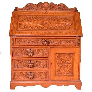 1515: 1515 CARVED SLANT FRONT DESK. c.1880. C
