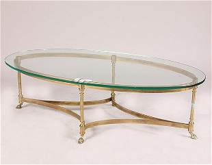 1565 BRASS AND GLASS COFFEE TABLE. Oval