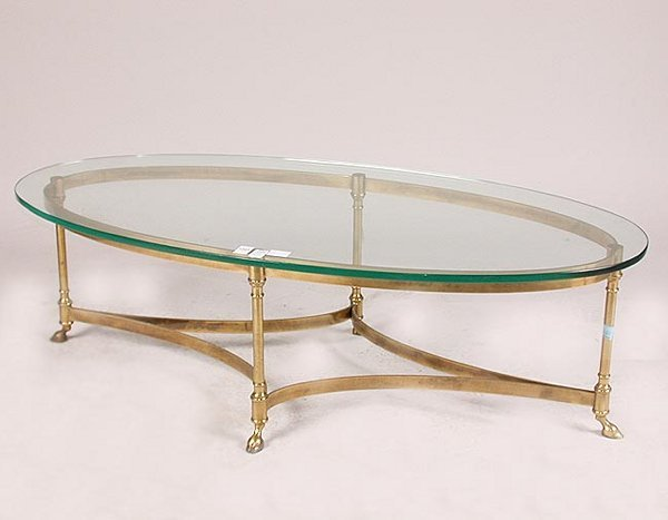 1565: 1565 BRASS AND GLASS COFFEE TABLE. Oval