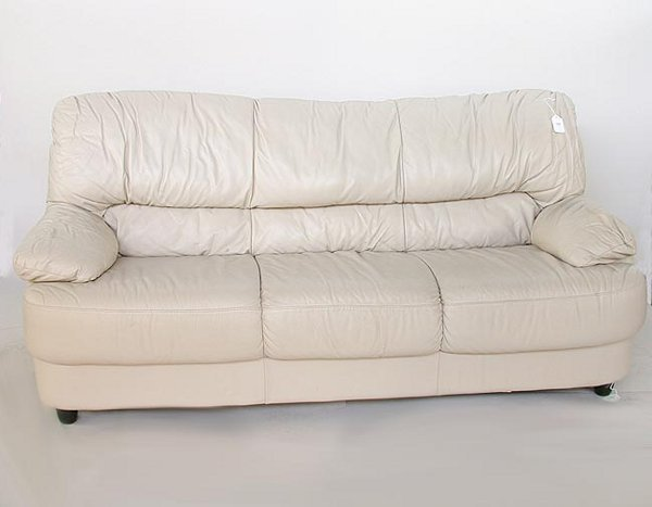 1569: 1569 CONTEMPORARY BEIGE LEATHER SOFA.