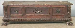 CARVED CASSONE. Paneled case with central medall