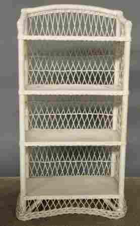 PAPER TWIST WICKER SHELF. Having four shelves an