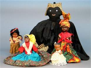 FIVE DOLLS. One is a storage caddy in the shape o