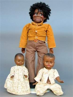 THREE BLACK DOLLS. One is a black baby doll with