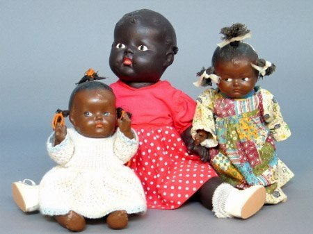 2023: THREE BLACK DOLLS. One is a black baby doll with